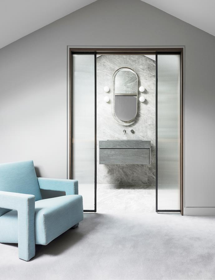 Italian porcelain bathroom tiles from Cerastone with tapware from Rogerseller. Custom porcelain vanity and mirror by Nina Maya Interiors with 'Mini Glo-Balls' wall lights from Euroluce and Cassina 'Utrecht' armchair from Space.