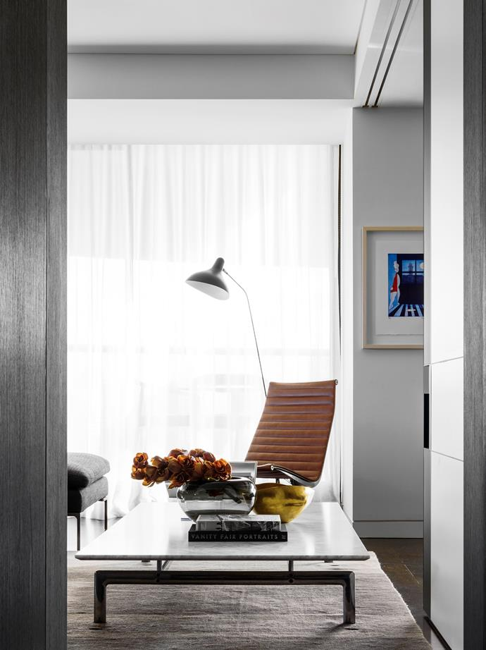 B&B Italia 'Diesis' coffee table from Space, Eames aluminium lounge chair from Living Edge and DCW 'Mantis' floor lamp from Spence & Lyda, all on a handwoven Iranian wool and silk rug. Untitled artwork by Charles Blackman.
