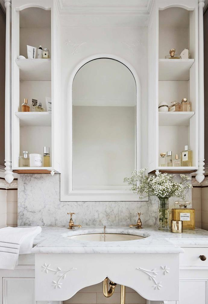 "In [Silvana Azzi Heras's renovated Italianate home](https://www.homestolove.com.au/italianate-victorian-home-19959|target=""_blank"") clever shelving nooks on either side of the mirror are natural homes for styled vignettes."