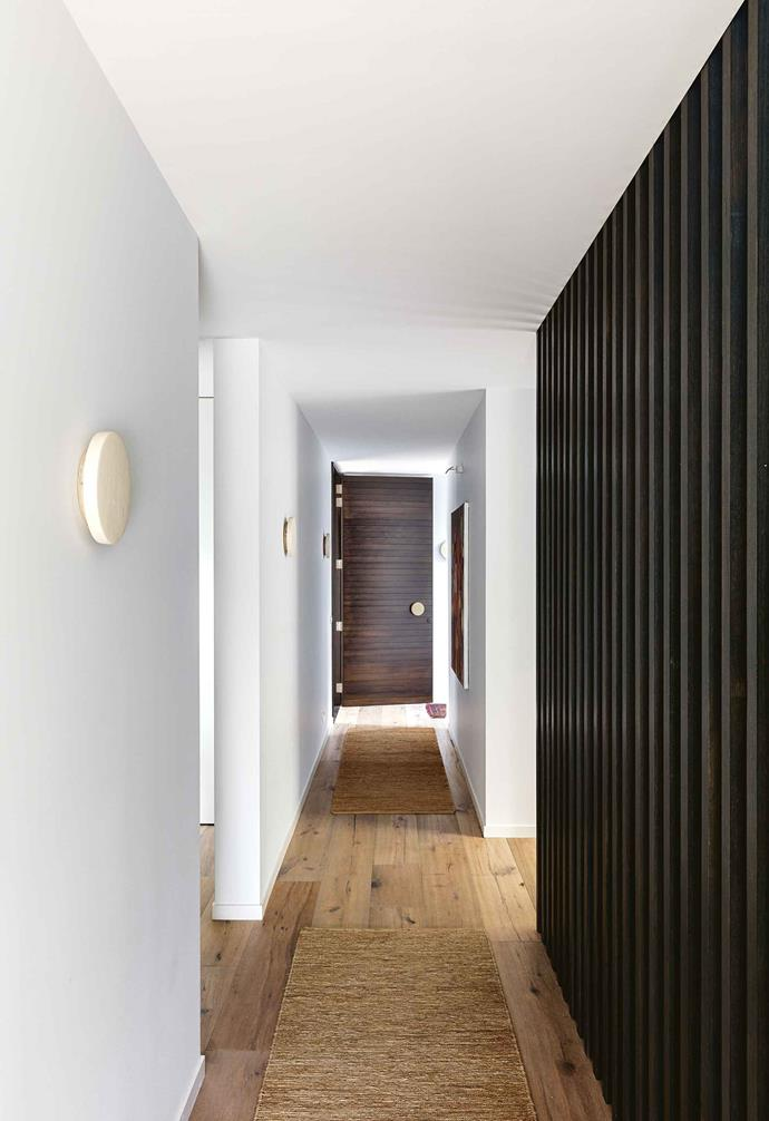 """Light is also important to me,"" says Pippa. ""I wanted this home to really make the most of the way the sunlight moved across the property and we really needed to be able to comfortably accommodate all the changing needs of a growing family.""<br><br>**Hallway** 'Aged Smoked & Limed' wide timber floorboards from [Royal Oak Floors](https://royaloakfloors.com.au/