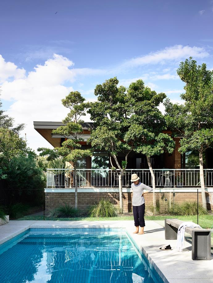 Andrea by the pool, which is now half its original size and surfaced with 50x50mm glazed tiles.