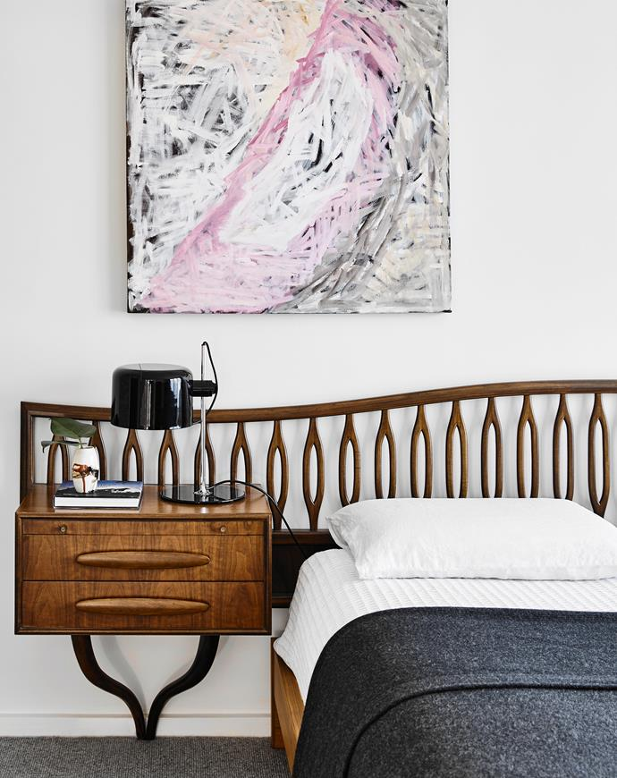A painting by Andrea Maddison hangs in the main bedroom. The bedhead was purchased with the house.