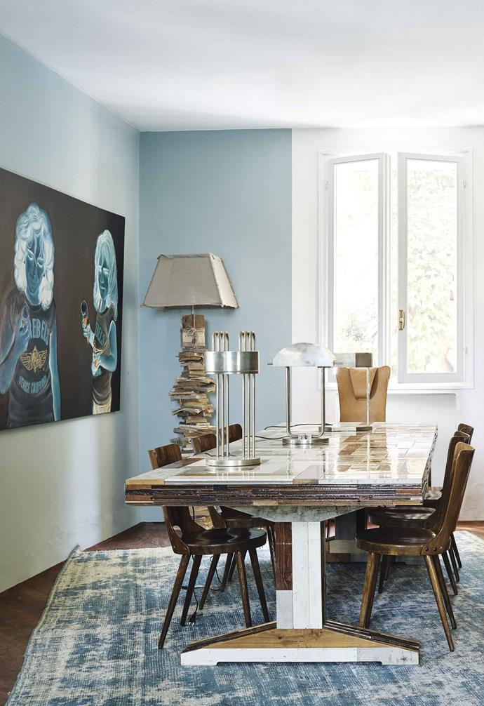**Dining room** The dining room does double time as a library. Table by Piet Hein Eek. Table lamp by Marcel Breuer. Artwork: Gabriele Talarico.