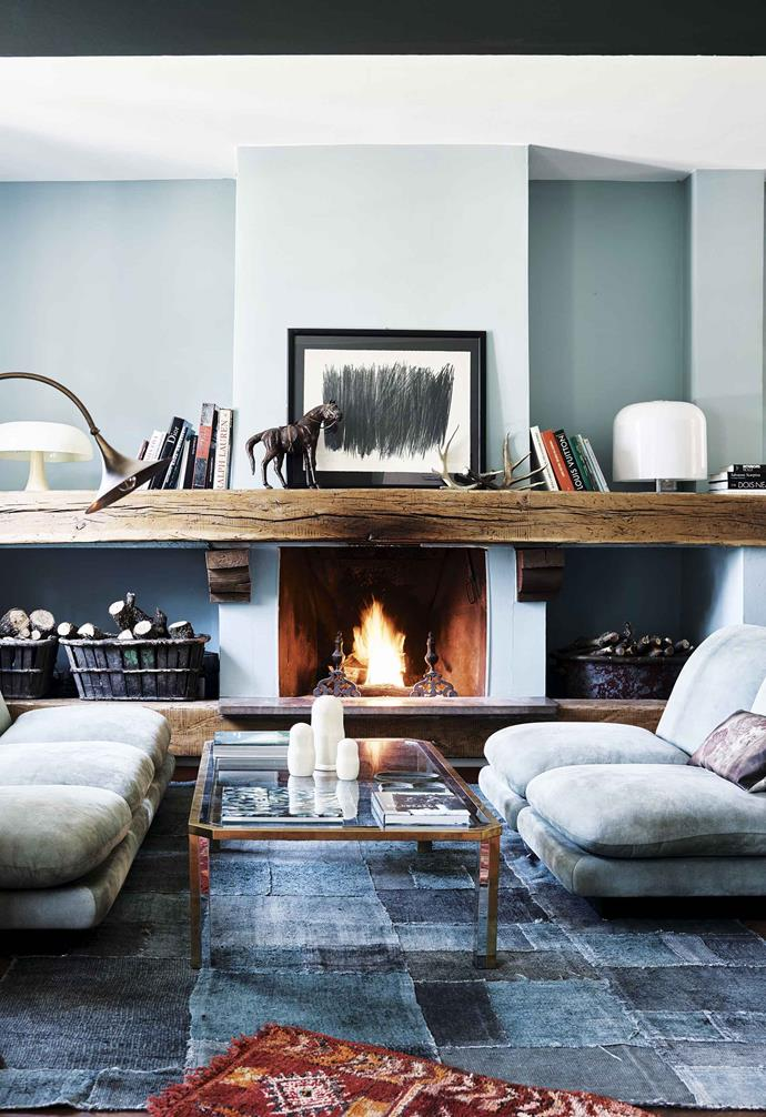**Living room** Slouchy suede sofas by Willy Rizzo, a patchwork rug from Turkey and a mantelpiece made from a timber beam create a space that is cosy and inviting, even when the fire isn't roaring. Artwork: Hans Hartung.