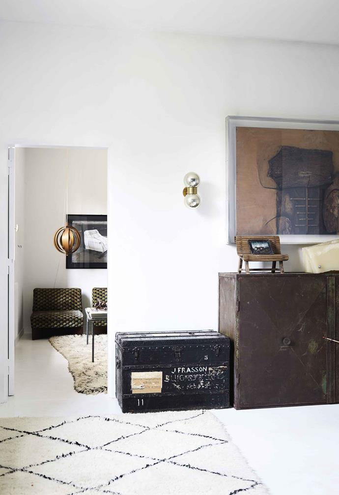 **Hallway** At the entrance to the main bedroom is a black Louis Vuitton trunk, once owned by a cartographer and dating back to Italy's military campaign in Africa. Vintage Beni Ourain rugs. Painted timber floors.