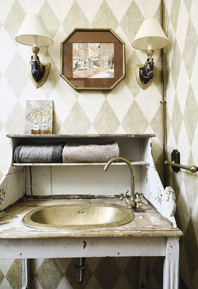 **Bathroom** Bought in Morocco 20 years ago, the brass basin was a perfect fit for the flea-market vanity. Floral artwork by Valentina.
