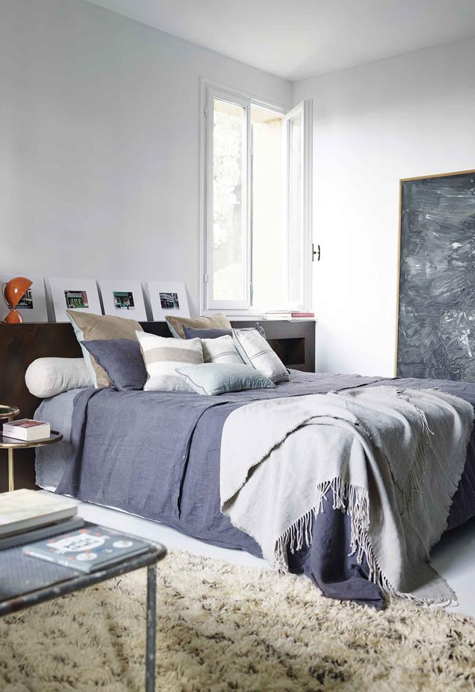 """**Main Bedroom** Textural layers continue into these desaturated sleeping quarters, where industrial furniture meets mid-century lighting. Linen, [Borgo Delle Tovaglie](https://www.borgodelletovaglie.com/en/