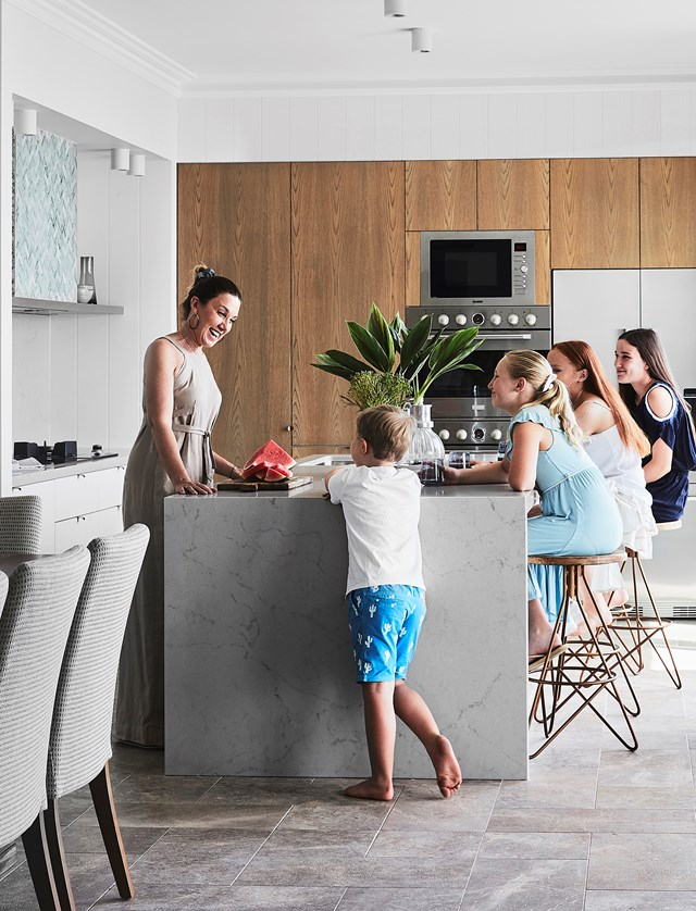 "A well-designed kitchen island will become a place everyone loves to congregate. Here, a [cottage was renovated](https://www.homestolove.com.au/cottage-turned-hamptons-style-home-20480|target=""_blank"") and extended to become a [multi-generational home](https://www.homestolove.com.au/multi-generational-home-living-19279