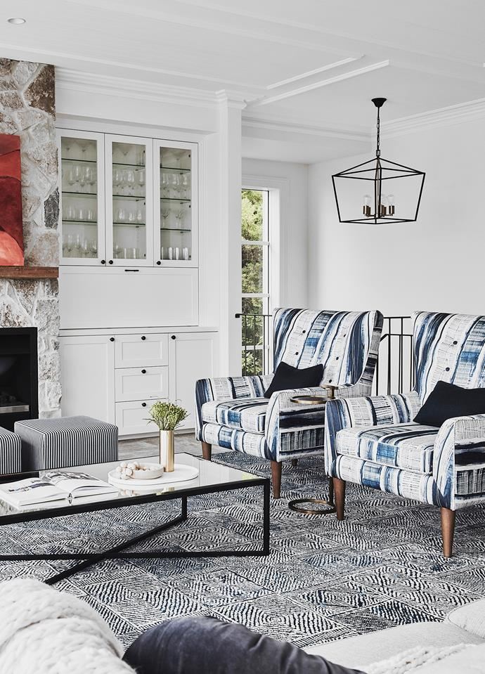 The restrained colour palette allows pattern and texture to take centrestage. Lamp, Emac & Lawton. Jetmaster fireplace. Sofa, Dale armchairs and Moreno rug, all Nick Scali. Avalon coffee table, Boyd Blue. Olivier pendant light (medium), Cafe Lighting & Living.