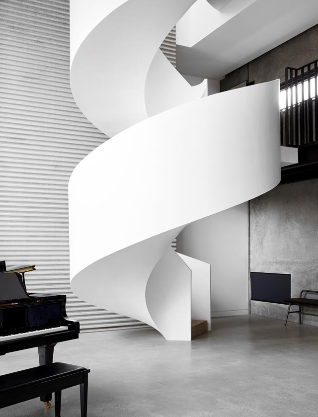 "The helical staircase in musician [Guy Sebastian's family home](https://www.homestolove.com.au/guy-sebastian-house-20443 |target=""_blank"") is forged in steel and encased in crisp white render. Architecture by Joe Snell. From *Belle* August/September 2019."