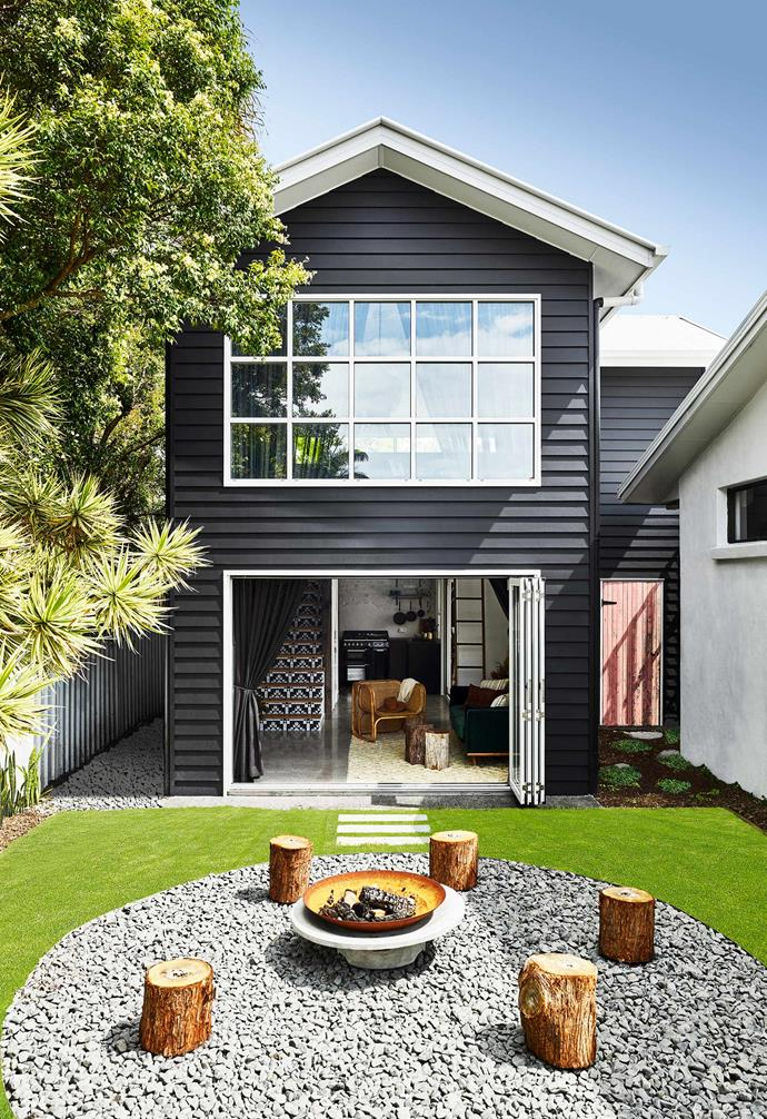 "Glass and aluminium bifold doors with a white frame connect this [chic small pool house home](https://www.homestolove.com.au/pool-house-19517|target=""_blank"") to a generous backyard and outdoor entertaining zone that is complete with a fire pit for winter gatherings."