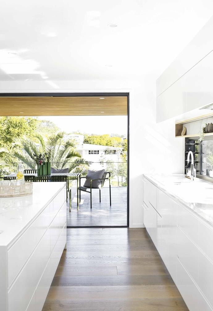"The open-plan kitchen and dining area of this [Palm Springs-style home in Coorparoo](https://www.homestolove.com.au/palm-springs-house-coorparoo-19769|target=""_blank"") opens directly onto a terrace that's perfect for outdoor entertaining and makes the most of sublime views."
