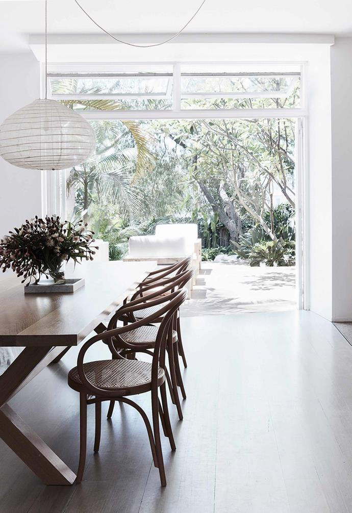 "In this renovated [Bondi duplex](https://www.homestolove.com.au/duplex-home-renovation-19533|target=""_blank"") the open-plan kitchen and dining zone features white-framed doors that open directly onto a generous white mahogany deck that's perfect for entertaining."