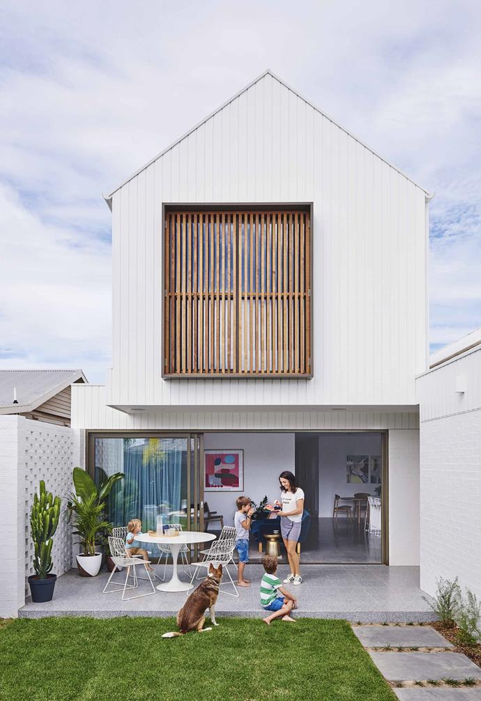 "**Star performer** Natural light is a huge selling point for potential buyers. Here, sunshine is drawn in with 4.5m-wide aluminium stacking doors in Anodised Bronze from Stegbar, along with matching windows throughout the home. They are [double-glazed](https://www.homestolove.com.au/double-glazed-windows-19772|target=""_blank"") to keep heat in during winter.<br><br>**Exterior** The cedar screening can be opened when the window needs cleaning. [Terrazzo floor tiles](https://www.homestolove.com.au/terrazzo-tiles-australia-15537
