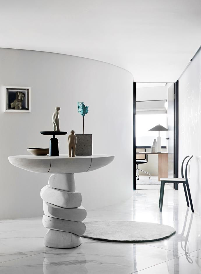 The Harry Seidler-inspired table by Den Holm holds ceramics by A Ceramics and Guido Deleu, a wooden centrepiece by Jaime Hayon and a sculpture by Guy Maestri. Daevid Anderson's Beauty artwork from Lethbridge Gallery hangs on the wall. Nanimarquina rug from Cult.