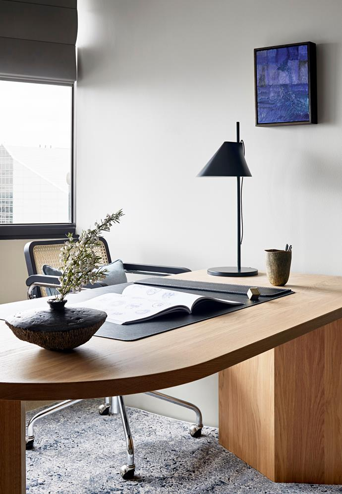 The custom desk is equipped with a Louis Poulsen 'Yuh' lamp from Cult and Thonet 'S 64 VDR' chair from Anibou.