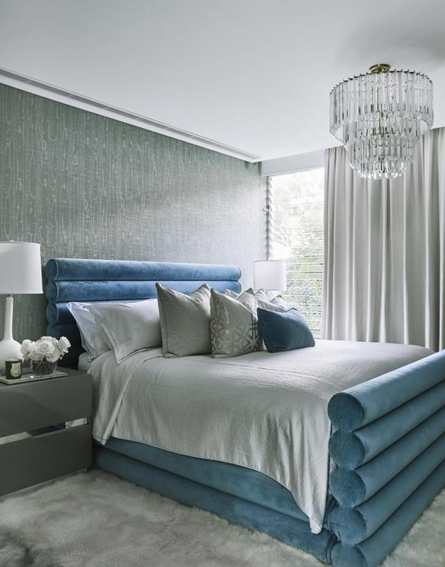 "A vintage chandelier from 1stdibs hangs in [Skye Leckie's](https://www.homestolove.com.au/inside-the-colourful-home-of-skye-leckie-20191|target=""_blank"") glamorous bedroom which was designed by Poco Designs."