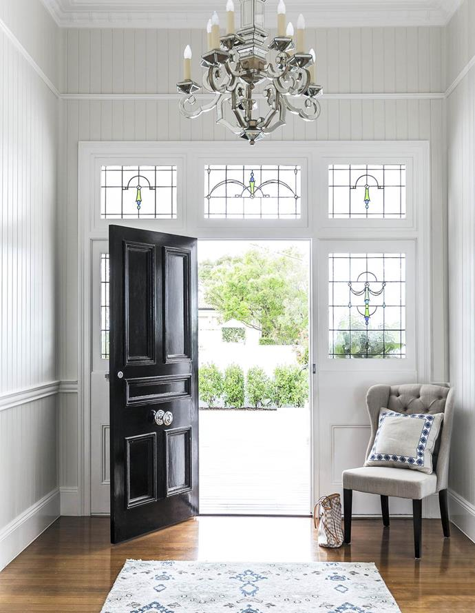 "A chandelier lights up the entryway to this [stately Queenslander](https://www.homestolove.com.au/classic-queenslander-updated-for-family-living-2577|target=""_blank"") and perfectly ties in with the homes period features."