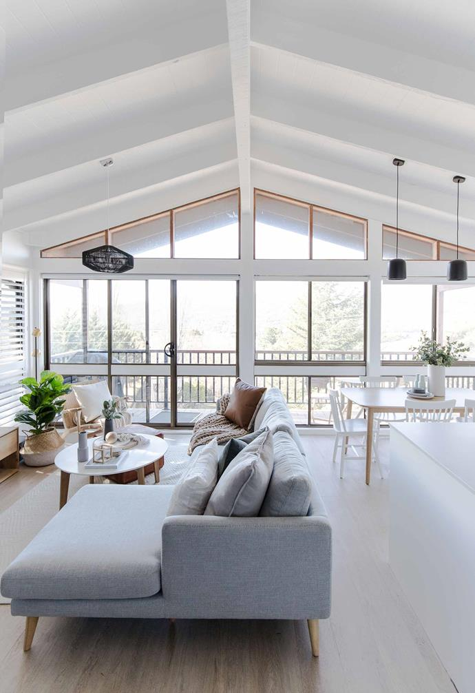 "In this [renovated ski retreat in Jindabyne](https://www.homestolove.com.au/explore-this-elegant-renovated-ski-retreat-in-jindabyne-7068|target=""_blank"") the open plan living space is further accentuated by striking exposed ceiling beams and a gently pitched roof. The living area is created organically with an L-shaped sofa which breaks up the space between the kitchen and lounging areas."