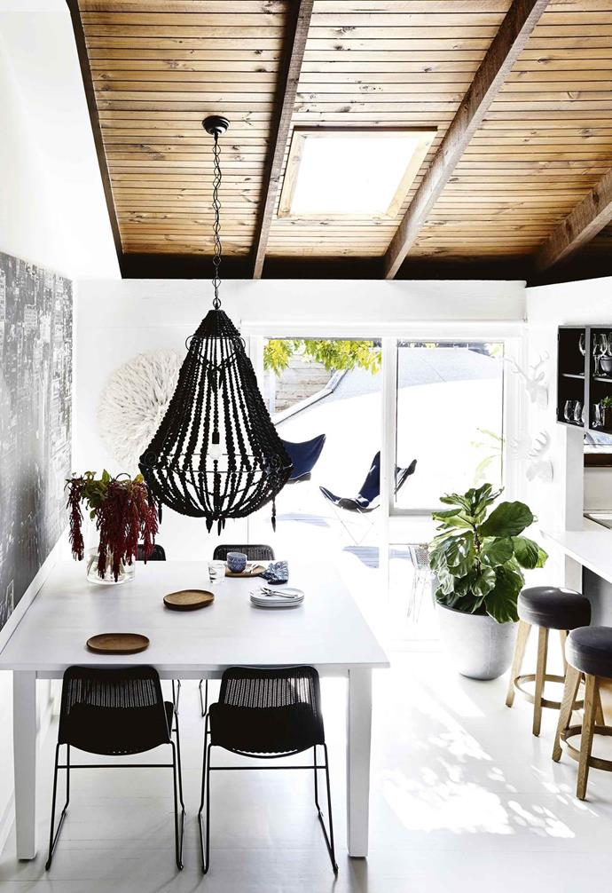"The beaded Weylandts chandelier over the dining table is a favourite feature in this [resort-style home](https://www.homestolove.com.au/resort-style-home-melbourne-17531|target=""_blank"") and offers a modern take on the classic chandelier design."