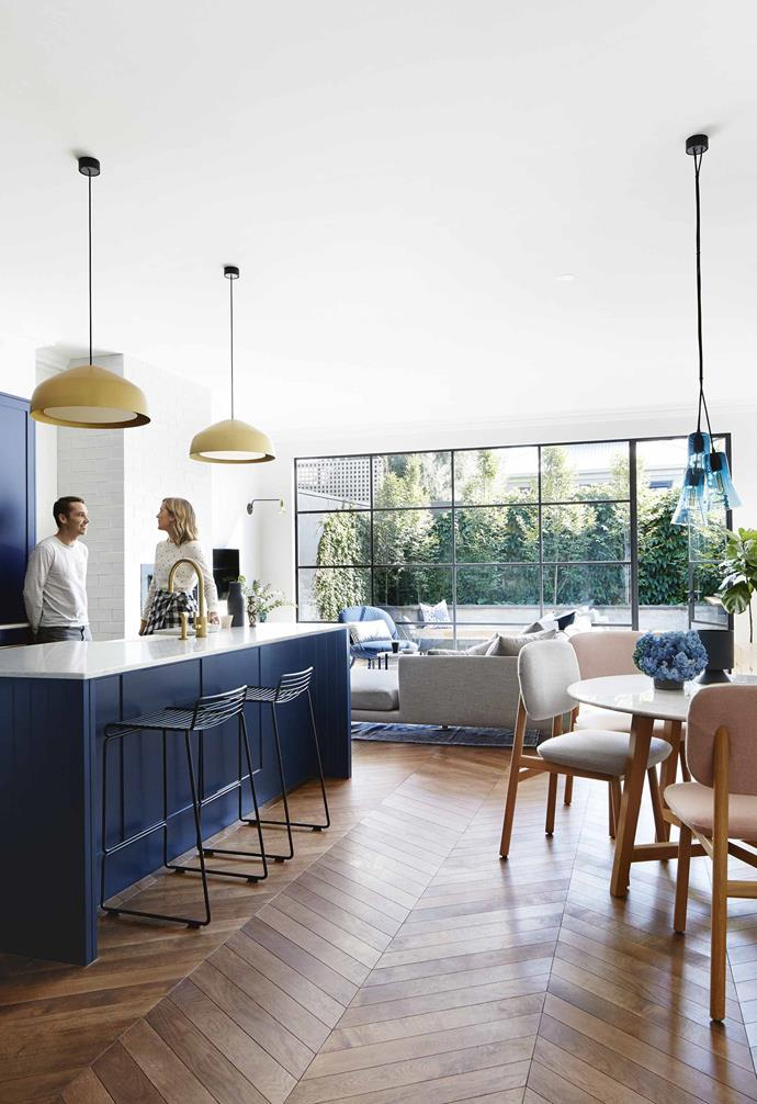 "Primed to make the most of ample natural light provided by generous steel-framed windows, the open-plan living area in this [Edwardian home](https://www.homestolove.com.au/modern-edwardian-semi-renovation-18524|target=""_blank"") positions the living space closest to the outdoor entertaining area, with a compact dining space sitting next to a generous kitchen island."