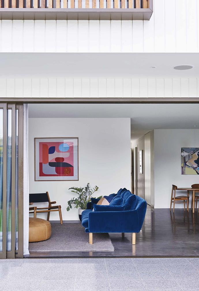 "In this [contemporary home in Geelong](https://www.homestolove.com.au/contemporary-house-geelong-17561|target=""_blank"") the house emphasises a seamless connection between the indoor and the outdoors, with the open-plan living/kitchen/dining area sitting alongside generous glass sliding doors."