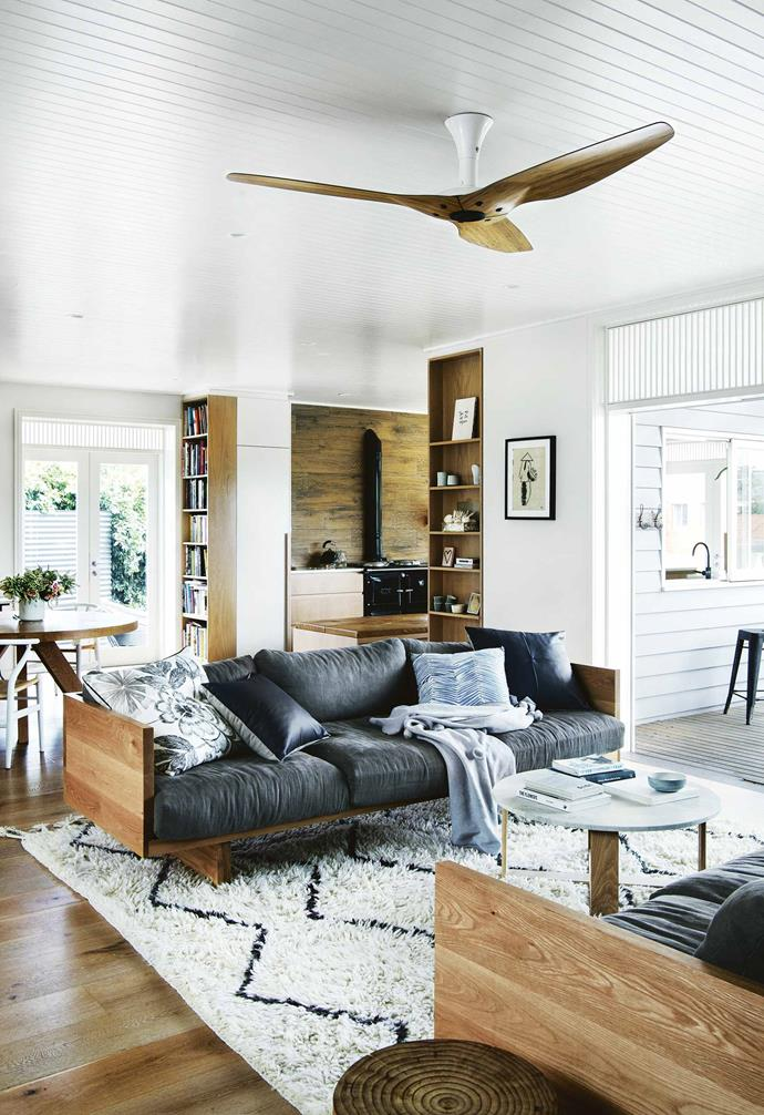 "A pair of lounges face eachother to create a cosy and intimate living zone in the open plan space of this [weatherboard home in Freshwater](https://www.homestolove.com.au/eco-friendly-weatherboard-house-freshwater-17440|target=""_blank""), complete with a striking Morroccan-style berber rug for a finishing touch."