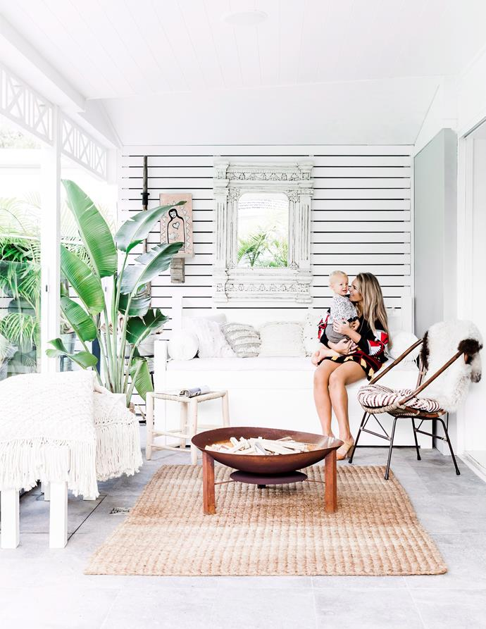"""**Install a fireplace** <br><br> A fireplace is the hub of a [cosy living room](https://www.homestolove.com.au/cosy-home-decor-3278 target=""""_blank""""). Dress the surrounding area in lush, thick fabrics and hide away from the cold. A [fire pit](https://www.homestolove.com.au/how-to-build-a-fire-pit-3240 target=""""_blank"""") has the same effect outside and makes entertaining outdoors a joy – even when it's freezing!"""