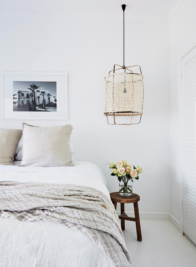 "**Let your bedroom be your sanctuary** <br><br> [Pure linen sheets](https://www.homestolove.com.au/buyers-guide-to-bed-linen-2562|target=""_blank"") and pillowcases are must-have ingredients for a bed you'll just want to swan dive into. Linen is a breathable fabric, making it ideal for all seasons, plus it gets softer with every wash. Add pillows of different shapes to serve different purposes, like napping or reading, and ditch the harsh, overhead lights and opt for warm, ambient lamplight."