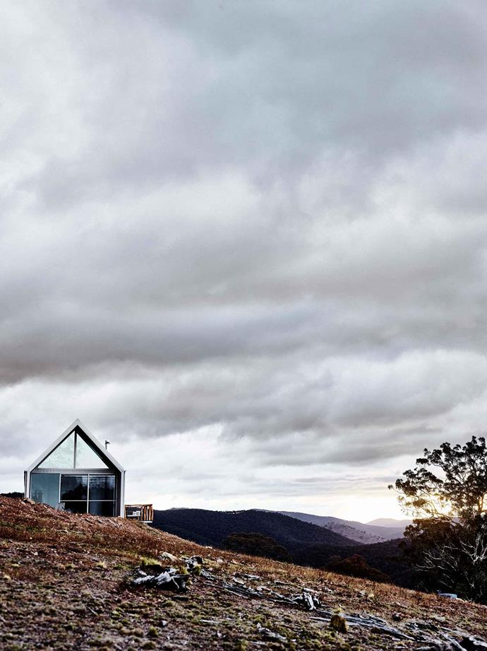 """The cabin features a steeply pitched roof and floor-to-ceiling windows by [Rylock](https://www.rylock.com.au/