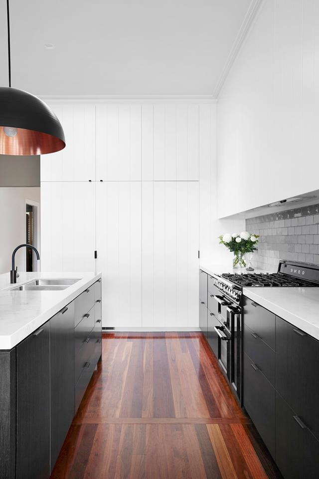 "A sleek and clutter-free kitchen conceived by designer [Stewart Horton](https://www.homestolove.com.au/contemporary-black-and-white-kitchen-design-4723|target=""_blank"")."