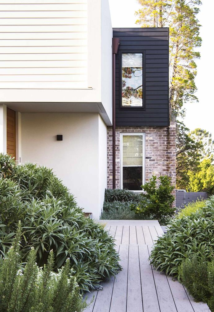 "Scyon 'Linea' cladding in different colours can be used to create visual contrast as seen here in this [contemporary home](https://www.homestolove.com.au/this-family-friendly-garden-is-a-lush-urban-haven-for-bees-7006|target=""_blank"")."