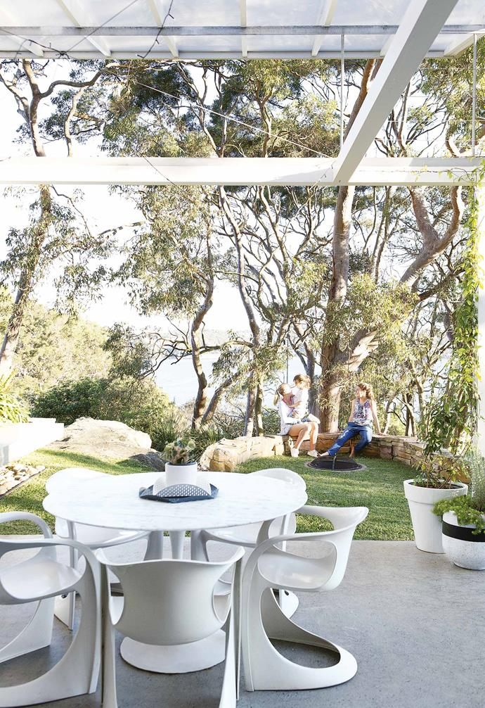 "**Exterior** The [fire pit](https://www.homestolove.com.au/best-fire-pits-under-100-6516|target=""_blank"") is a favourite spot. 'Casalino' chairs by Casala stay true to the retro heritage of the home. 'Geo' tray, [Tait](https://madebytait.com.au/