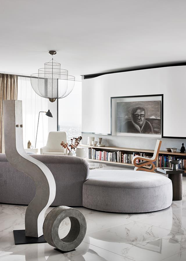 """Alicia Holgar deployed shapely curves within this [Brisbane apartment](https://www.homestolove.com.au/luxurious-apartment-filled-with-art-20492