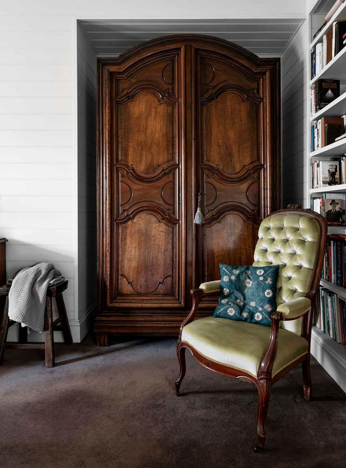 The walnut armoire was purchased in Paris in 1997.
