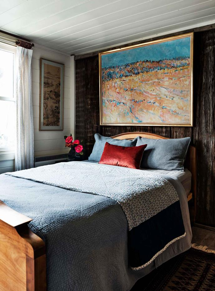 An original timber slab wall is a feature in one of the bedrooms.