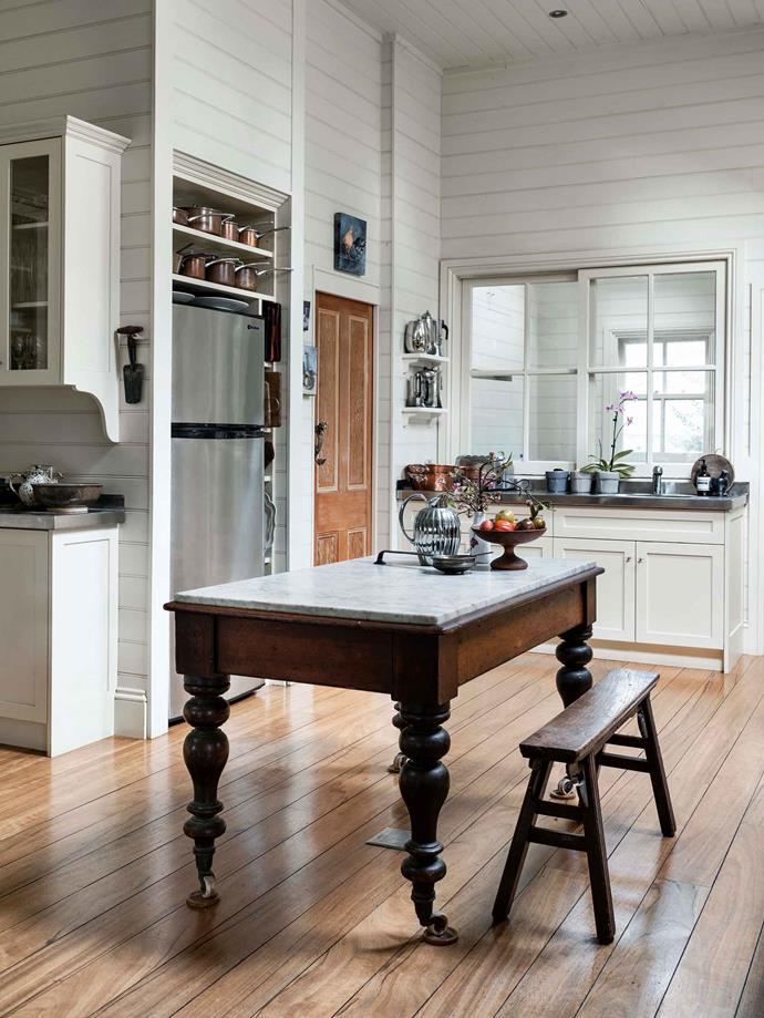 The marble-topped kitchen table is often the centre of activity in the kitchen.