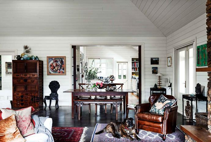 The large living room takes up almost the entire footprint of the original cottage. The 1980s painting of pomegranates is by Canberra artist Vicky Dabro, depicting fruit from Eric and Clive's Canberra garden.