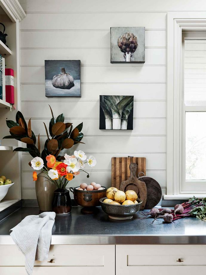 Food-themed still life artworks in the kitchen are by local artist James King.