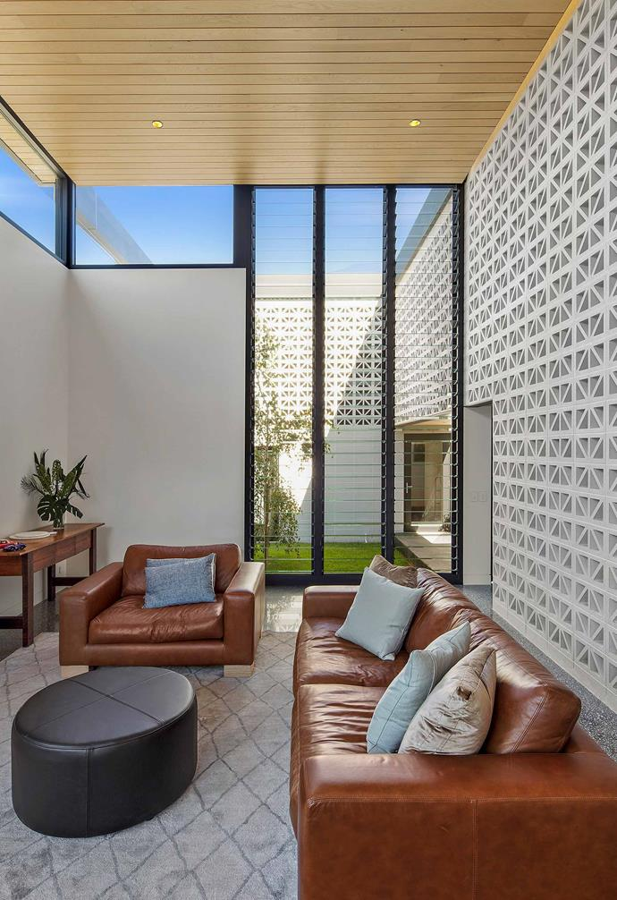 Breeze blocks run both internally and externally in this contemporary home with the internal feature wall simultaneously providing privacy and inter-connectivity between this living room and the rest of the home.