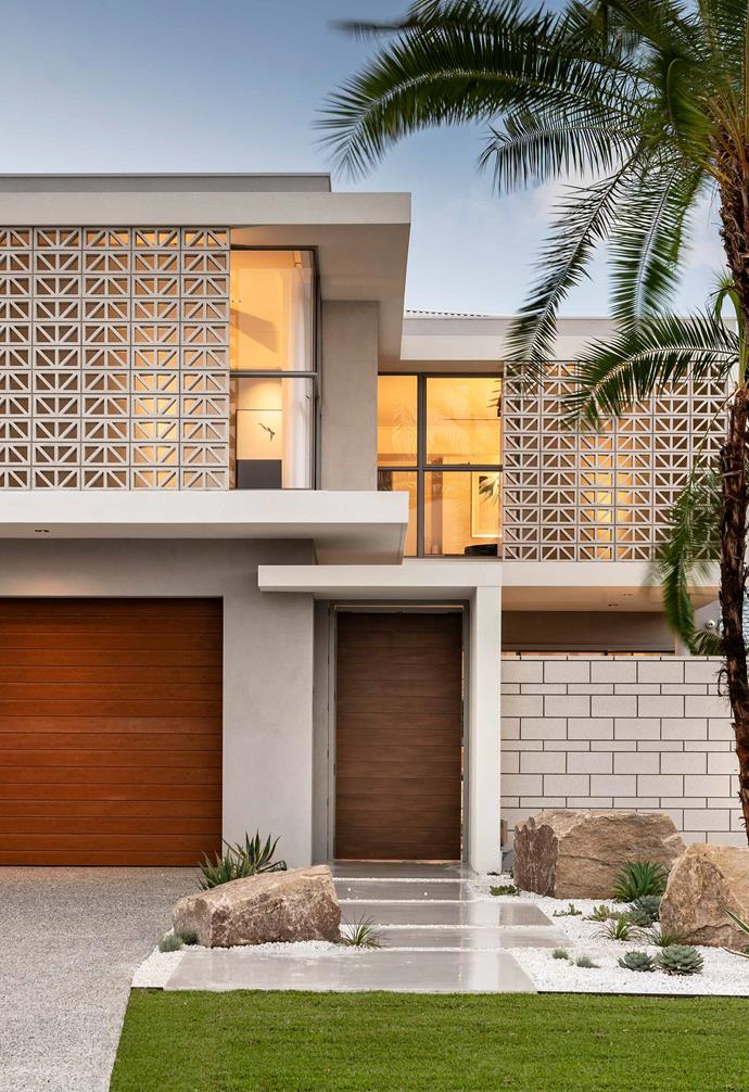 The breeze blocks used in the facade of this home allow the home to make the most of its stellar views, allowing the rooms to peer outside of the home while retaining privacy from the street. They also act as a creative exterior design feature that instantly ups the home's kerb appeal.