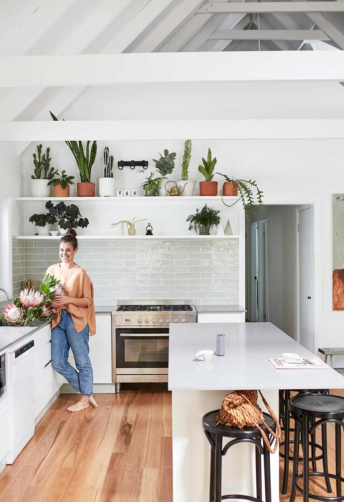 """**Kitchen** Mikarla's flawless arrangements of house plants brings instant personality, colour and drama to the plain walls and simple shelves. Glossy subway tiles from [Beaumont Tiles](https://www.beaumont-tiles.com.au/
