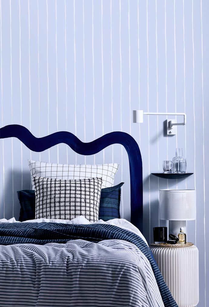 Cole & Son 'Marquee Stripes' wallpaper in Pale Blue, $175 per roll.