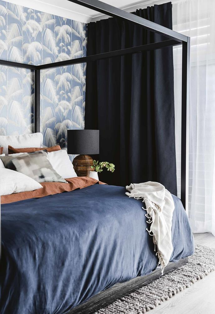 A playful palm tree wallpaper adds bold personality to the bedroom.