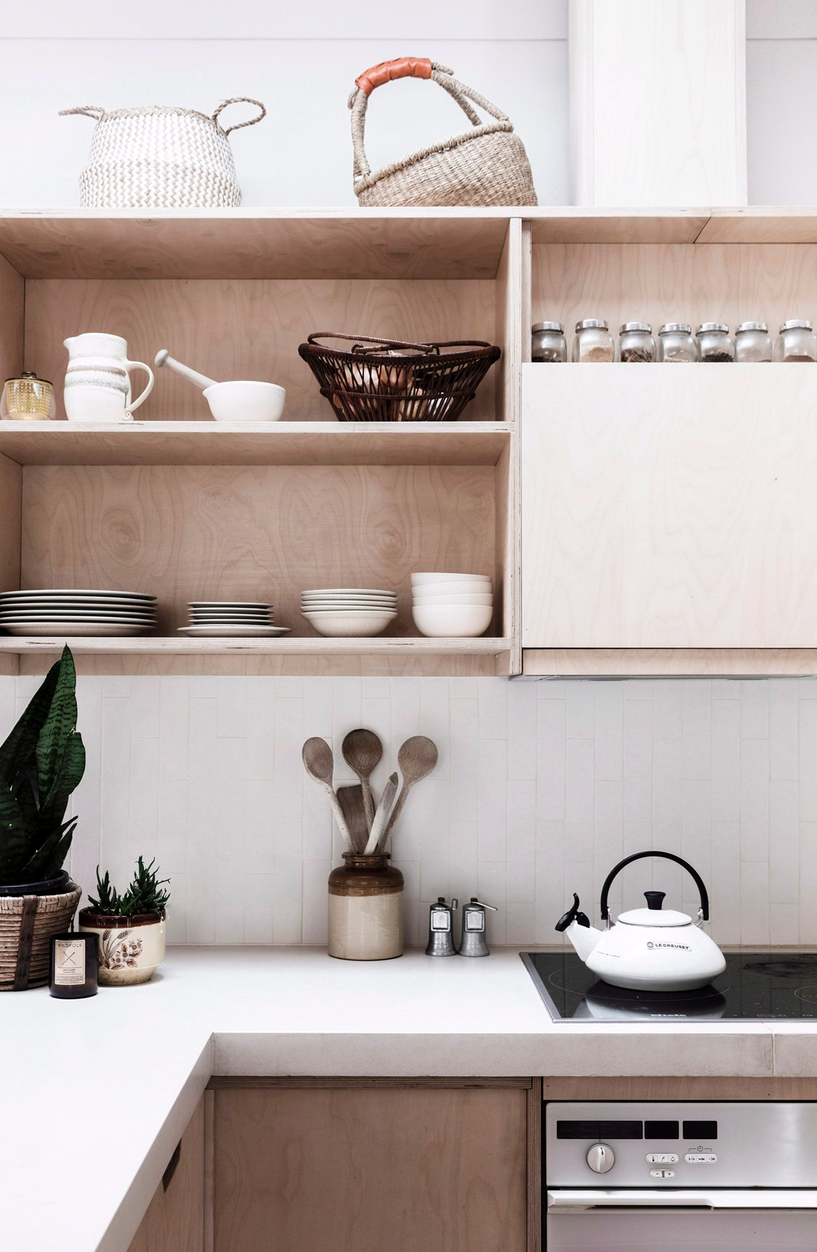 "Simple and affordable plywood shelving gives the kitchen in this [1970s-style bungalow](https://www.homestolove.com.au/a-1970s-byron-bay-bungalow-updated-with-hygge-style-6983|target=""_blank"") a no-fuss feel. All the overhead cabinetry is open, with all the most-used crockery and glassware on display."
