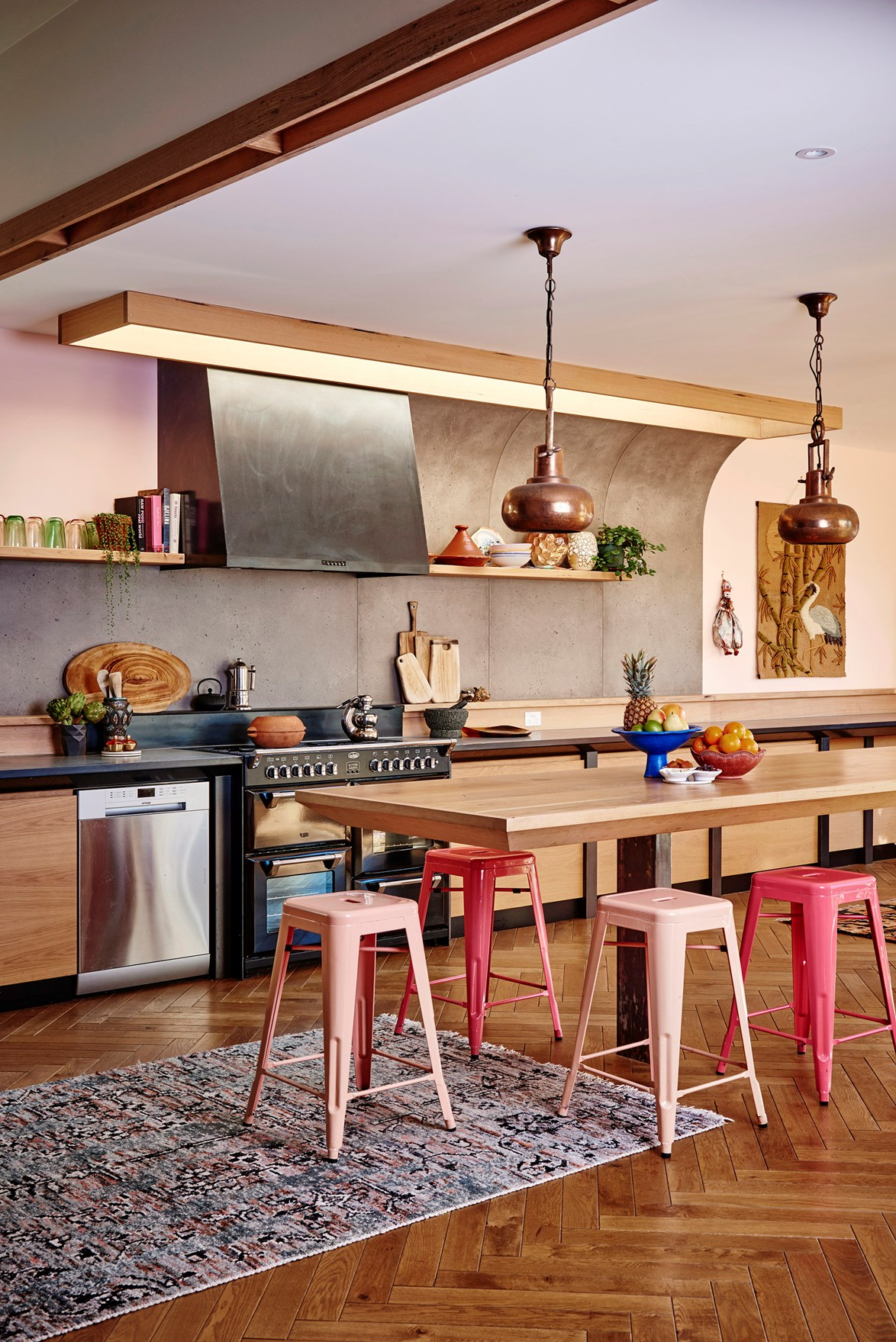 "A single timber floating shelf that positioned above the main food prep area, either side of the rangehood, is the perfect place to keep cookbooks within easy reach. Indoor plants and coloured glassware make this [colourful kitchen](https://www.homestolove.com.au/colourful-kitchens-2017-6052|target=""_blank"") even more vibrant!"