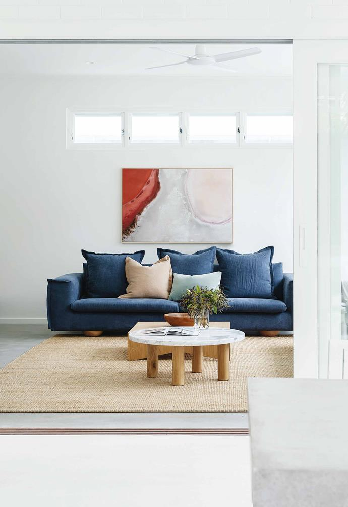 "**Living room** Modern and functional was the design brief here. Floor-to-ceiling windows look out to the pool. Sunny sofa and Cove coffee table, both from [Jardan](https://www.jardan.com.au/|target=""_blank""