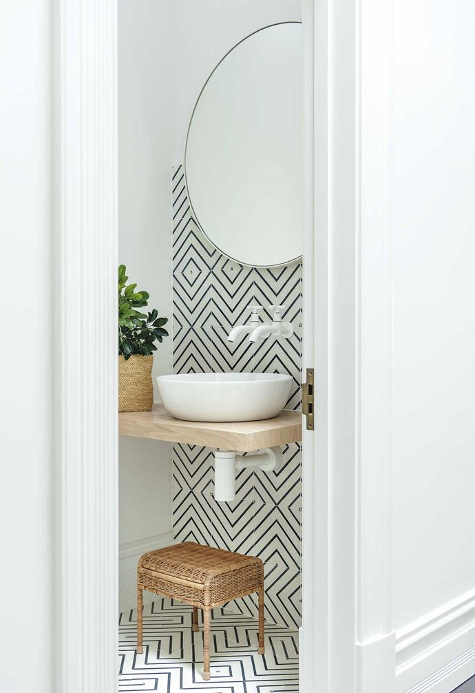 "**Powder room**  ""Wet spaces can be playful and distinctive but still in keeping with the concept,"" says Lara. Oak veneer vanity. Tiles from [Surface Society](https://byronbaytilemerchants.com.au/