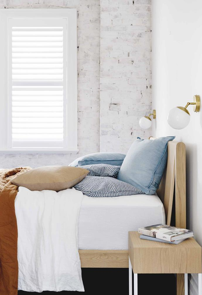 "**Main bedroom** ""Exposing the original bricks was a reminder of the home's heritage,"" says Caroline. The Finley bed is from [Jardan](https://www.jardan.com.au/