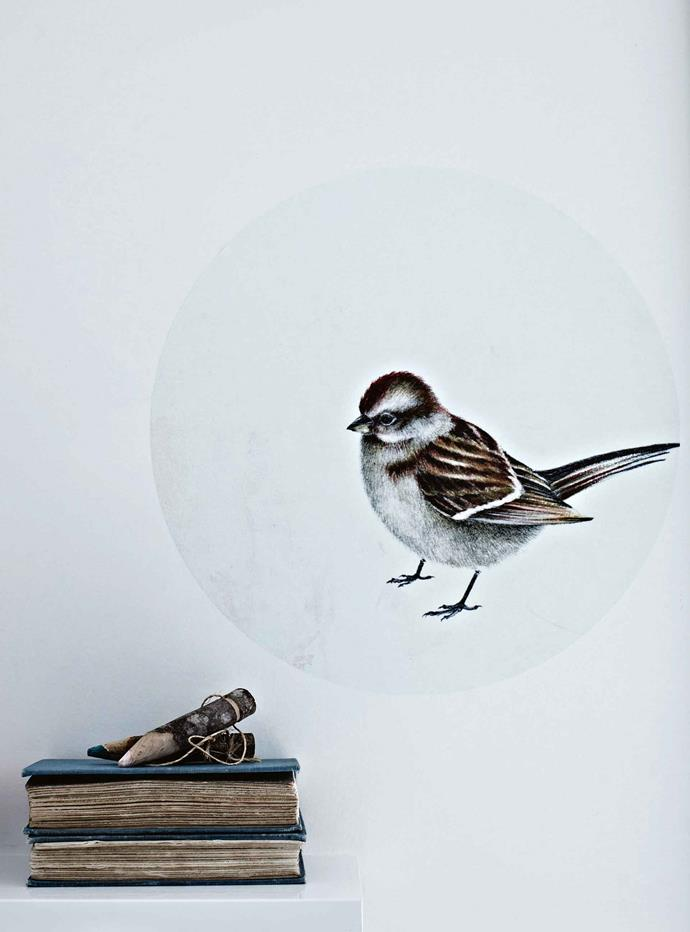 A bird wall decal from Pony Rider overlooks vintage books and pencils.